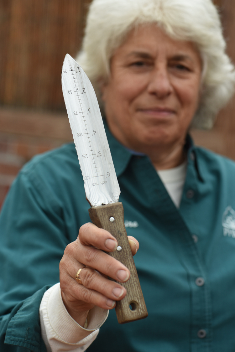 Claire Dusak, outdoor display foreman for the western campus of Phipps Conservatory and Botanical Gardens shows off her hori hori knife. It was the most popular gift mentioned by readers in a Facebook post by Tribune-Review home and garden editor Doug Oster.