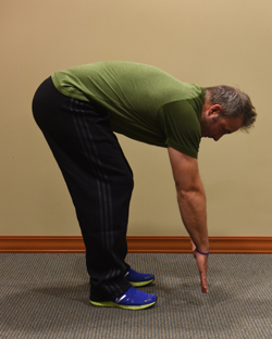 Ryan Taucher, exercise physiologist for Excela Heath shows how to do a good stretch for the lower back and hamestrings.