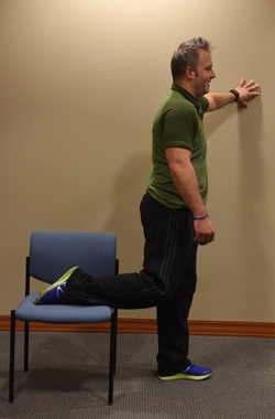 Ryan Taucher, exercise physiologist for Excela Heath shows how to do one version of a stretch for quadricep muscles.
