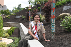 Jaime Martinez, 15, sits in the garden he helped create outside the Hillman Cancer Center in the Bairl Pavillion at UPMC Passavant in McCandless. He raised $37,426 in donations for the garden. This was his Boy Scout Eagle Scout service project.