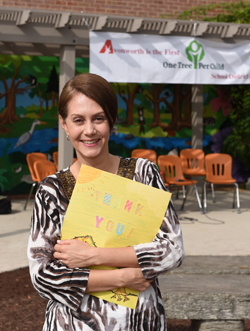 Isabela Angelelli, a pediatrician from Ben Avon holds a thank you card from the students at Avonworth Elementary in Ohio Township. Angelelli was the force behind bringing the One Tree Per Child program here. The school is the first in the United States to be part of the program which also iruns in eight other countries.