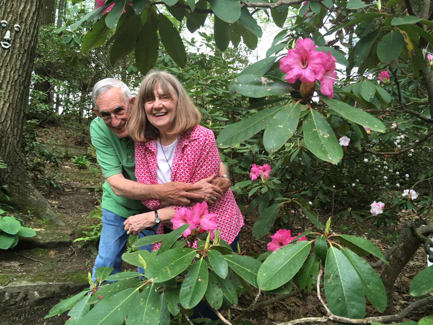 "L.G. ""Spike"" Walters and his wife Kay pose with a beautiful rhododrndron in their Butler garden."