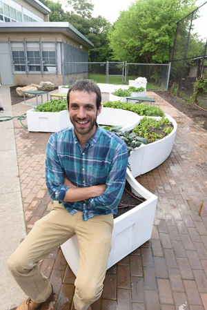 Jake Seltman, Grow Pittsburgh's executive director sits in the Learning Garden at Clayton Academy in Pittsburgh's Northside neighborhood. The garden is made possible through a partnership between Grow Pittsburgh and the national organization Big Green.