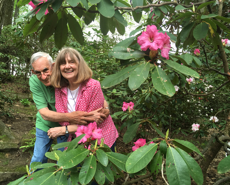 L.G. (Spike) Walters and his wife Kay pose with a beautiful rhododendron in their Butler garden.
