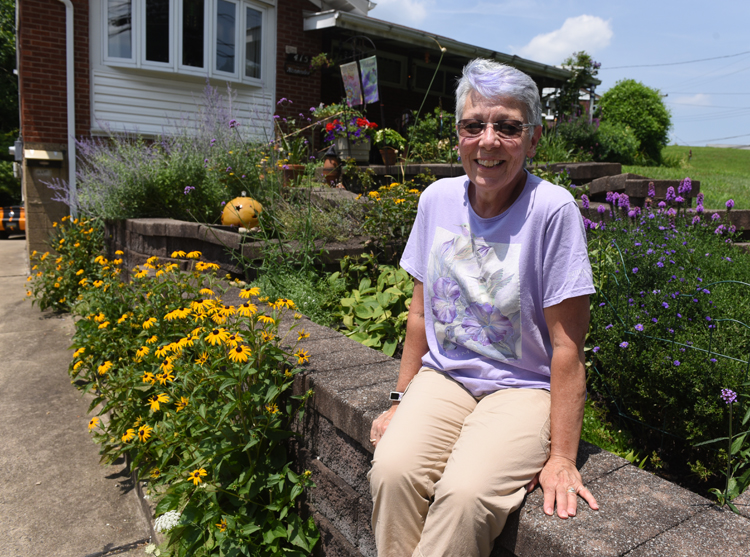 Marsha Kennedy of Wilkins Twp. grows a colorful garden for pollinators and cares for roses which are a family heirloom. Photos by Doug Oster