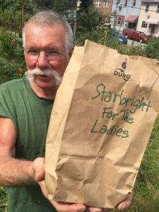 "Tom Walker is the ""Garlic King of Millvale."" He's donated two pounds of his homegrown garlic to be planted in the garden at SCI Cambridge Springs, a minimum security women's prison in Crawford County. Photo by Doug Oster"