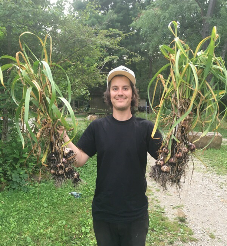 Dan Tomcik shows off his harvest of garlic he inherited from Dennis Gilkey.