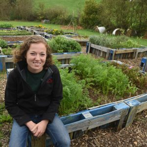 Morgan Livingston is agricultural innovations manager at the Greater Washington County Food Bank. She looks over the raised beds at the garden behind the food bank. Over 450 pounds of produce came out of the garden for clients.