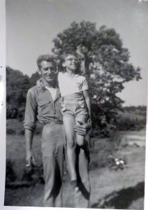 Milton Beatty holds his daughter Wanda (Beatty) Gerber is his arms. Gerber spent as much time as possible with her father in the garden. She grows many of his plants and also her great grandmother's dahlia.