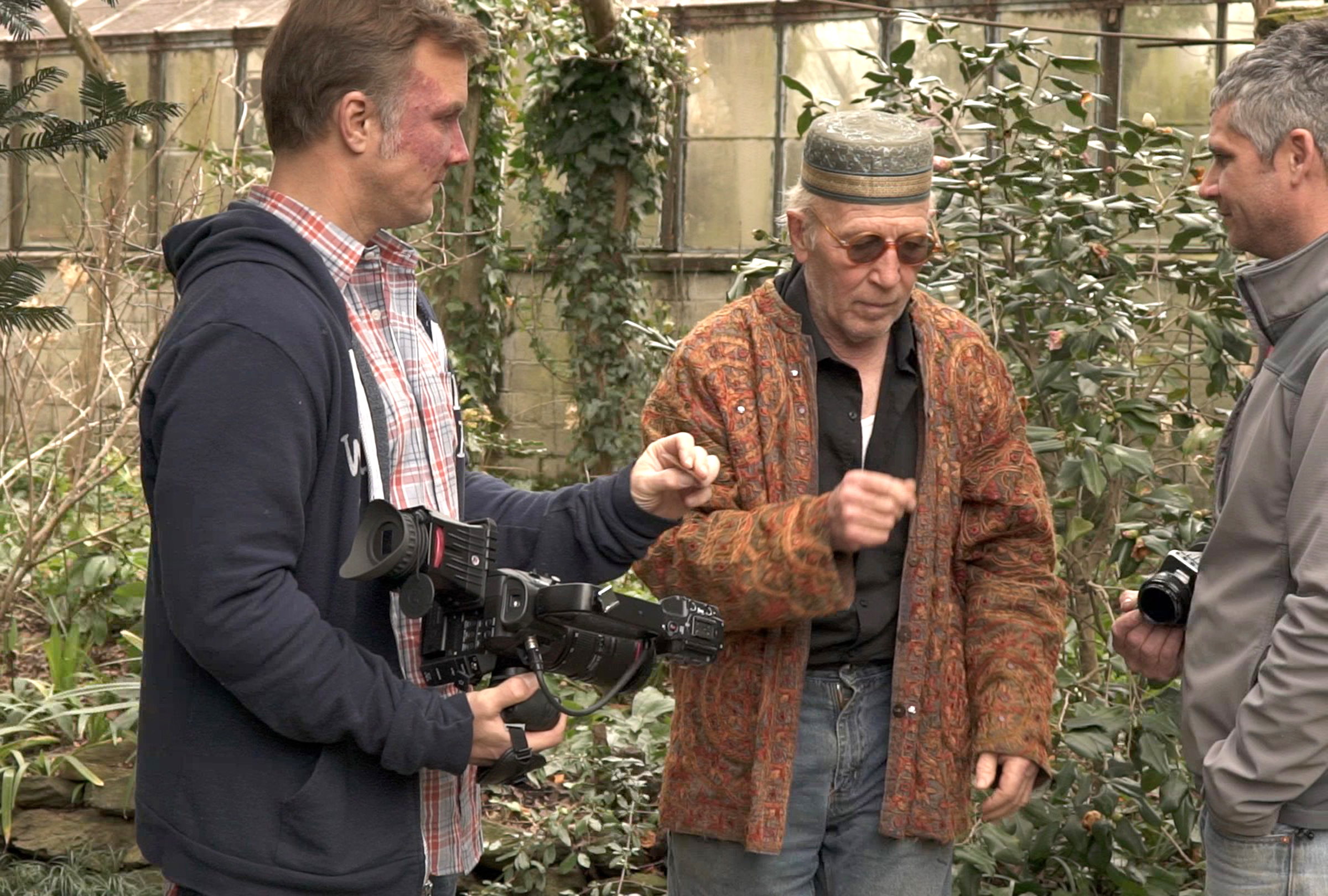 Ryan Gainey is a self taught plantsman and garden designer featured in the documentary The Well-Placed Weed: The Bountiful Gardens of Ryan Gainey. Gainey loved to dress up in unique clothes. (L to R) Steve Bransford, Ryan Gainey and Cooper Sanchez.