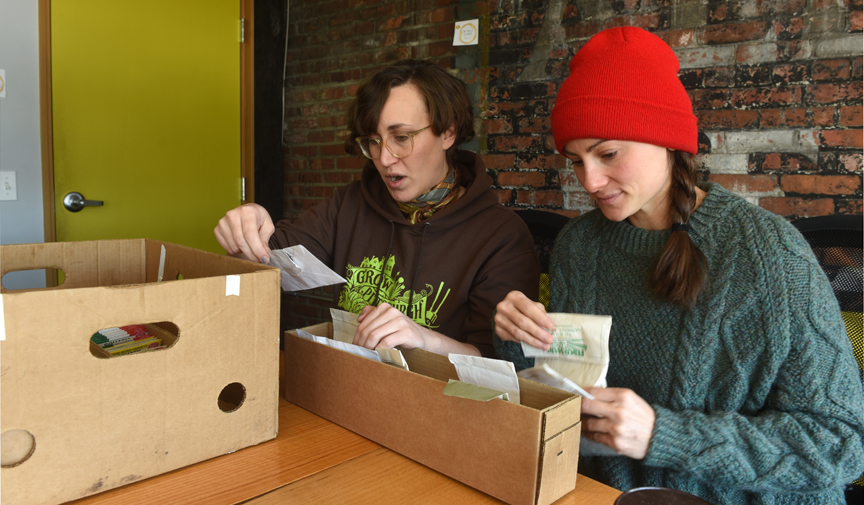 Alyssa Kail of Grow Pittsburgh and Lauren Delorenze from Phipps Conservatory and Botanical Gardens looks through some of the seeds that will be offered at A Celebration of Seeds: 7th Annual Seed and Plant Swap held on Feb. 23, 2019 at the main branch of the Carnegie Library of Pittsburgh.