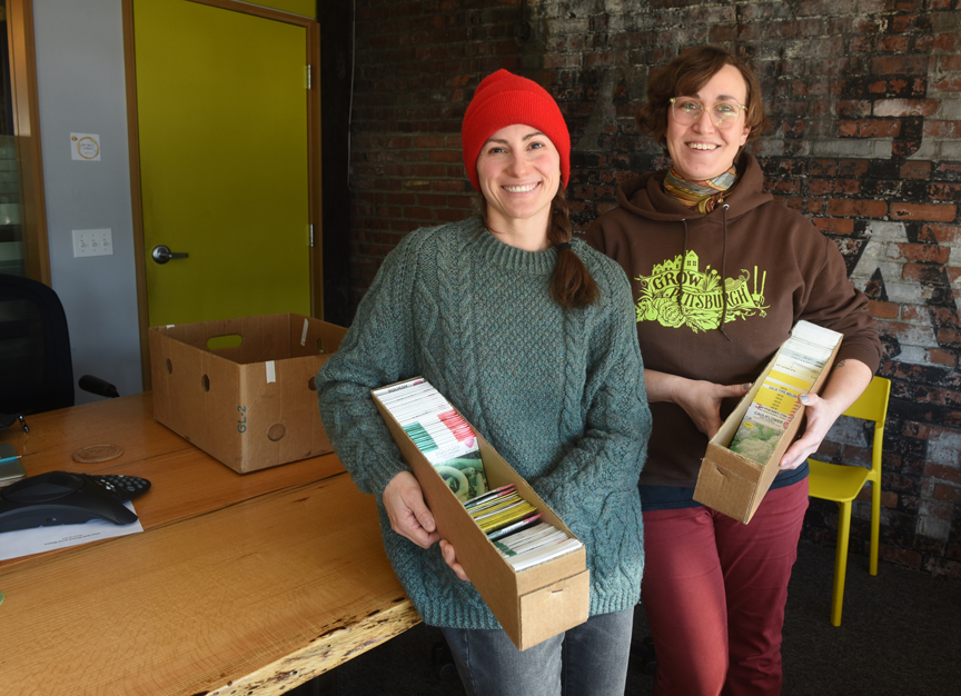 Lauren Delorenze from Phipps Conservatory and Botanical Gardens and Alyssa Kail of Grow Pittsburgh hold seeds that will be offered at A Celebration of Seeds: 7th Annual Seed and Plant Swap held on Feb. 23, 2019 at the main branch of the Carnegie Library of Pittsburgh.