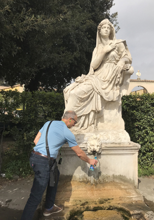 David Nigro fills his water battle from Fontana Della Zitella at the enterance to the Vatican Gardens.