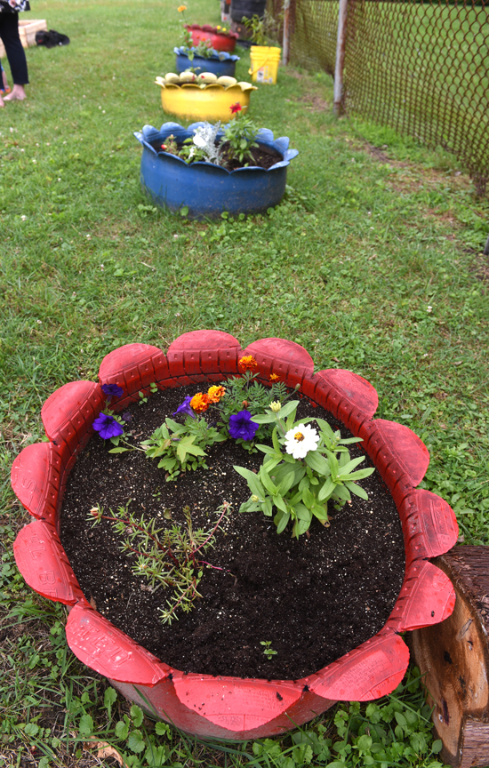 These decorative tires are filled with flowers at the children's garden in Vandergrift's Franklin Park. It's a project of the Vandergrift Parent Project.