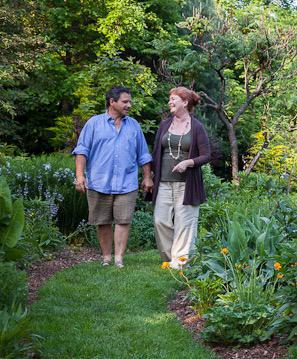 Peggy Anne Montgomery walks in the garden with her husband Dan Benarcik. Photo by Helen Norman