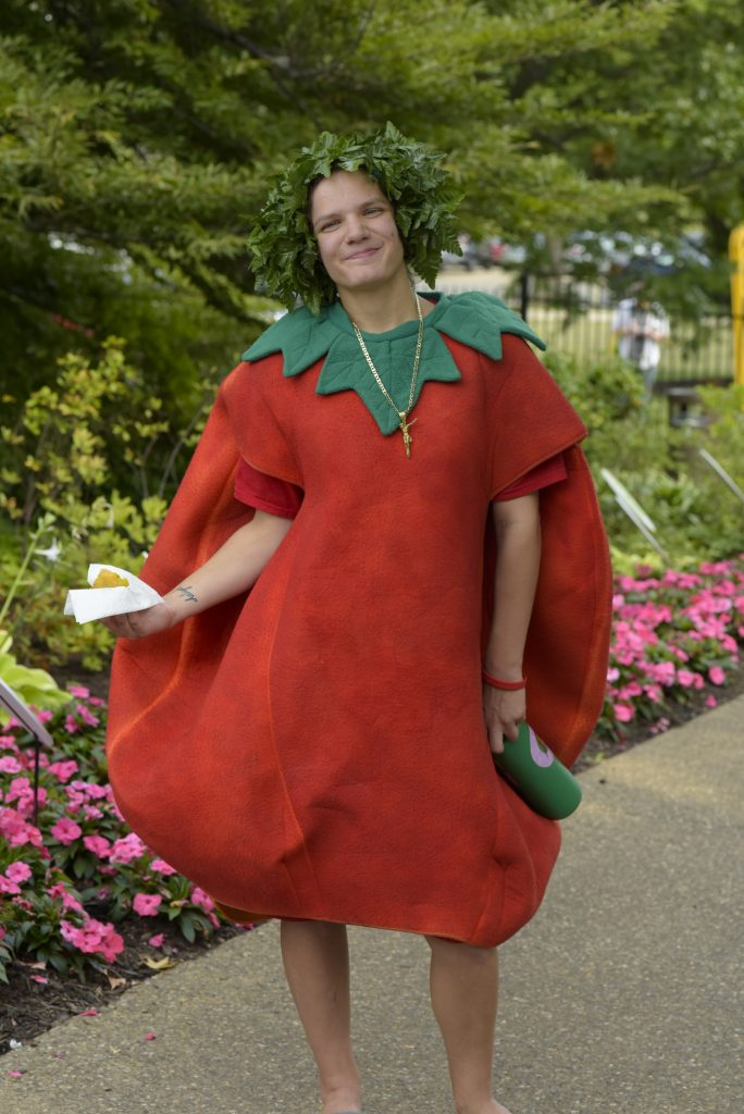 Stephanie Oster gets $25 from dad to dress up like a tomato each year at Tomato and Garlic Day. Photo by Paul g. Wiegman