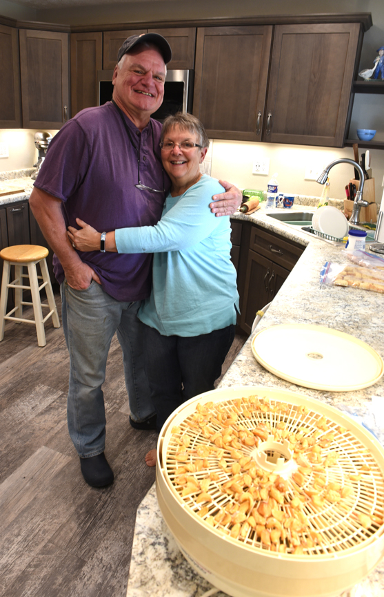 With garlic cloves drying in the foreground Bruce and Susan Ellis of McCandless pose for a portrait in the kitchen.