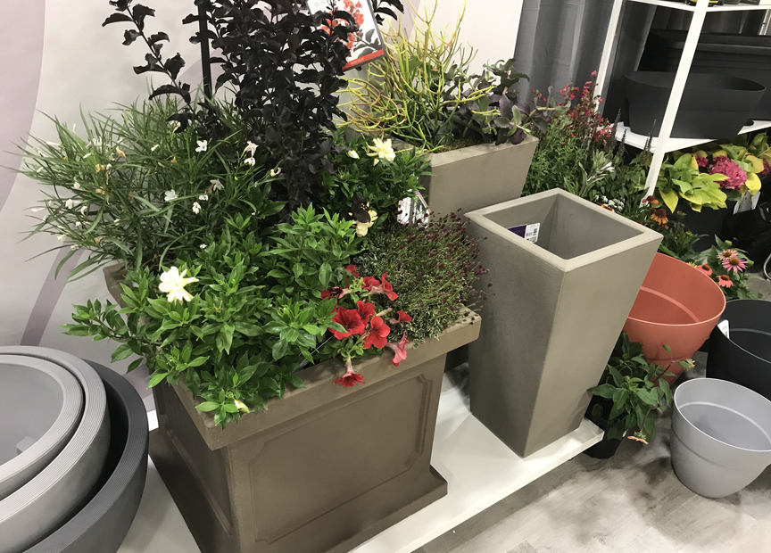 Some of the lightweight containers on display in the Cresent Garden booth at Cultivate '19 in Columbus, Oh.