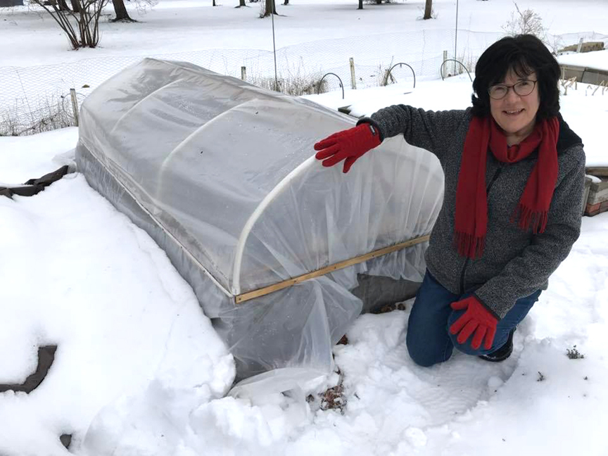 Sue Gilmore has been gardening most of her life. She's growing a wide variety of plants and wants to up her game when it comes to winter gardening. Here she poses with a mini hoop house to grow winter vegetables.